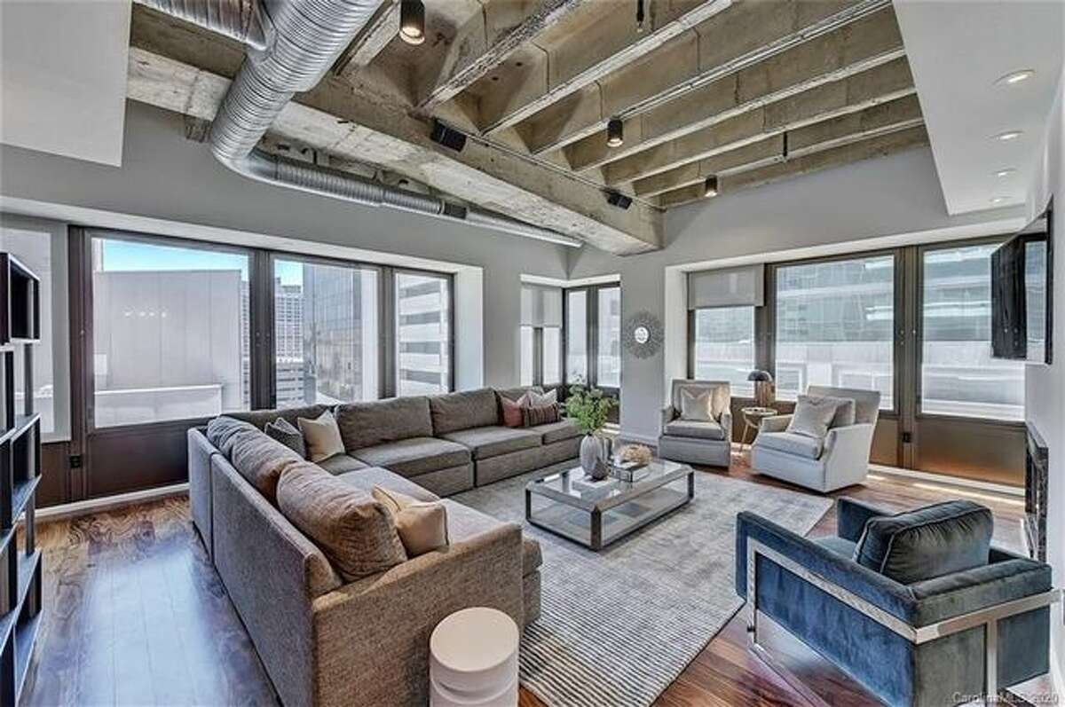 Gleaming hardwood floors cover most of the interior and exposed ductwork and concrete ceilings lend the unit a loftlike vibe.