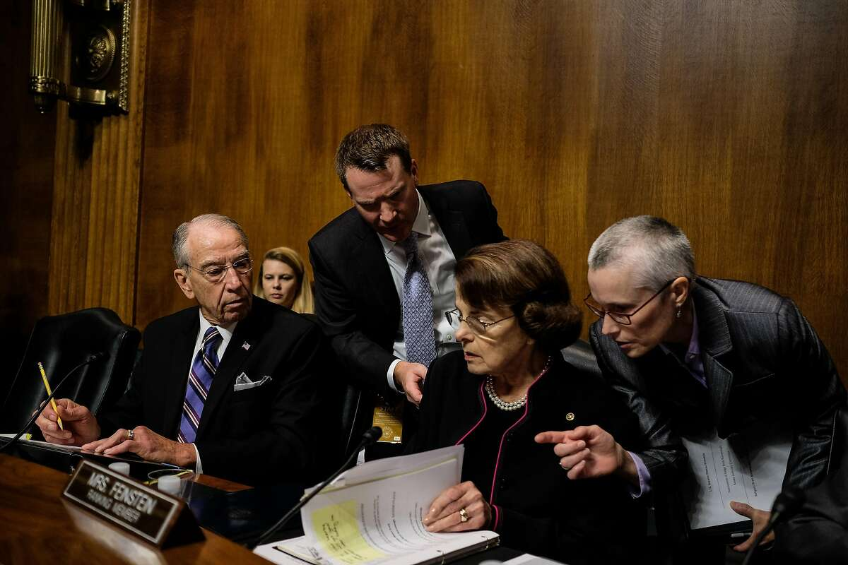 WASHINGTON, DC - SEPTEMBER 27: U.S. Senate Judiciary Committee Chairman Chuck Grassley (R-ID) and ranking member Dianne Feinstein (D-CA) talk with aides during testimony from Christine Blasey Ford and Supreme Court nominee Brett Kavanaugh at the Dirksen