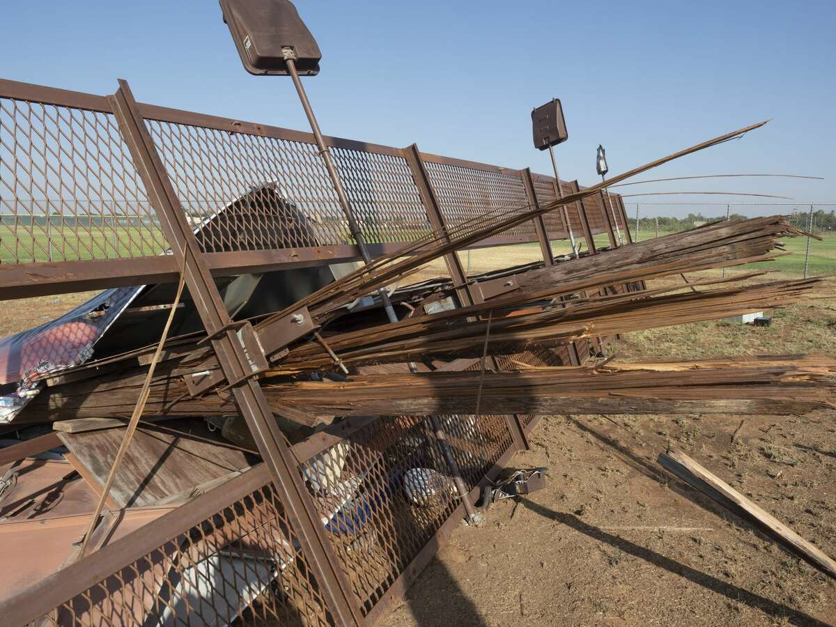 High winds that blew in with the storm Thursday evening in northeast Midland left damage 07/03/2020 in the area of north Big Spring and Loop 250 with a billboard blown over and fencing around Midland High softball fields torn off. Tim Fischer/Reporter-Telegram