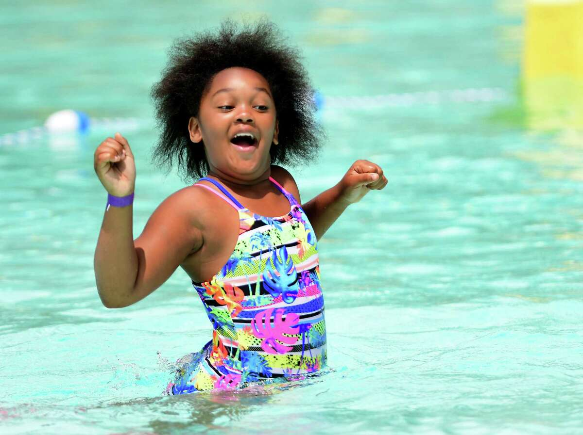 Serenity McKnight, 9, of Albany gets used to the coldness of the water as she takes her first swim at the Lincoln Park pool on Friday, July 3, 2020 in Albany, N.Y. (Lori Van Buren/Times Union)