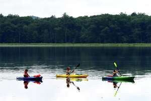 Amber Smith, left, Laura Murray, center, and Debbie Smith, right, all of Melrose, enjoy a morning paddle around Round Lake on Friday, July 3, 2020, in Round Lake, N.Y. (Will Waldron/Times Union)