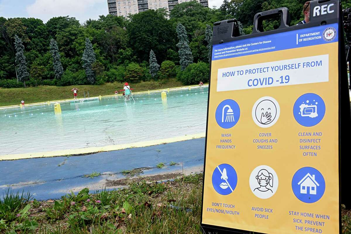 Rules to protect people from COVID-19 are posted at the Lincoln Park pool on Friday, July 3, 2020 in Albany, N.Y. The Albany pools opened today. (Lori Van Buren/Times Union)
