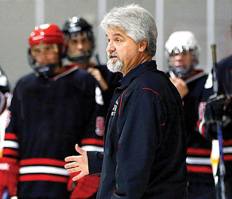 Mike Edwards has stepped down after a season as head coach of the Alton High hockey team. Edwards had a previous stint as the Redbirds coach before moving on to coach at SIUE. Photo: Billy Hurst File | For The Telegraph