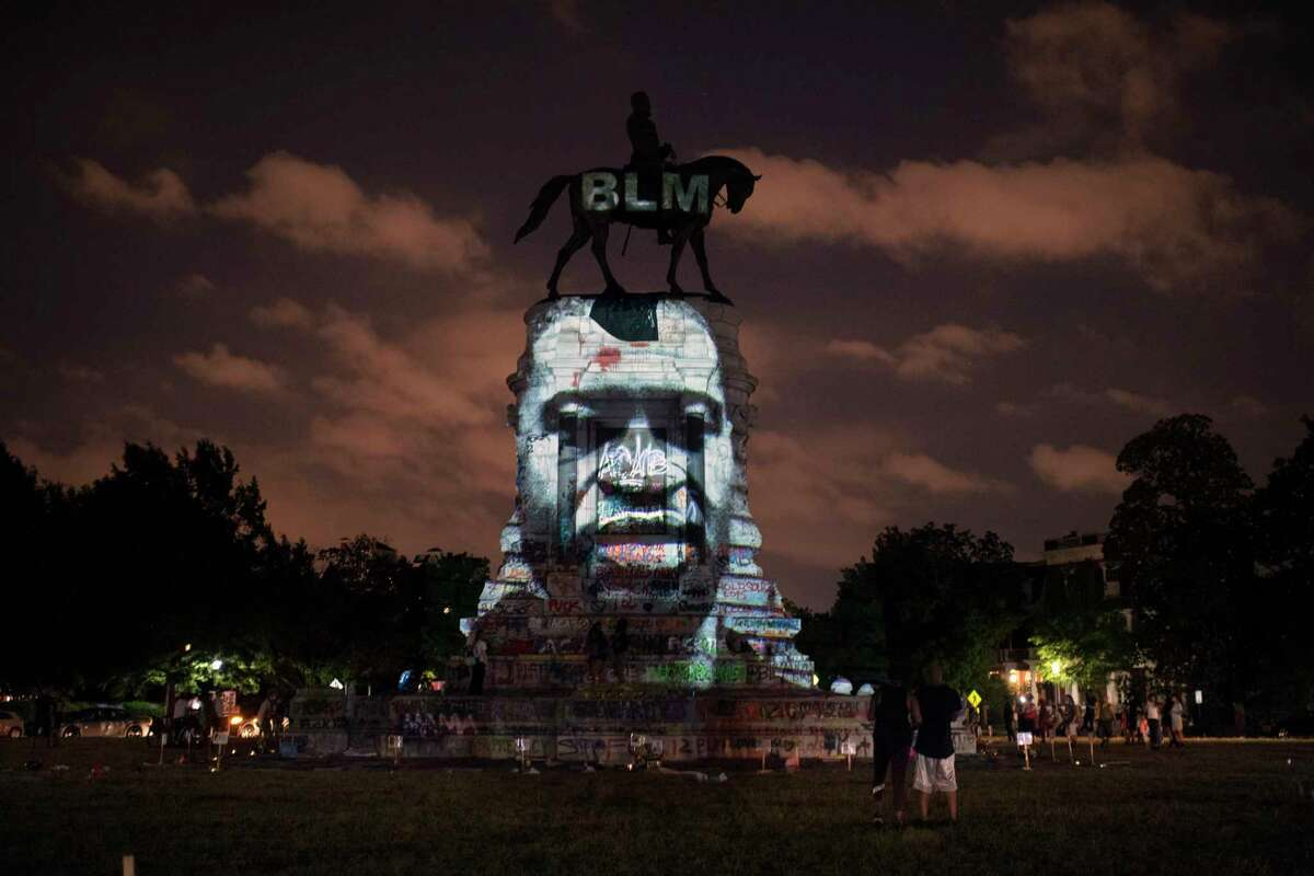 The image of George Floyd along with the Black Lives Matter letters are projected on to the Robert E. Lee Statue on Monument Avenue in Richmond last month. MUSTCREDIT: Washington Post photo by John McDonnell