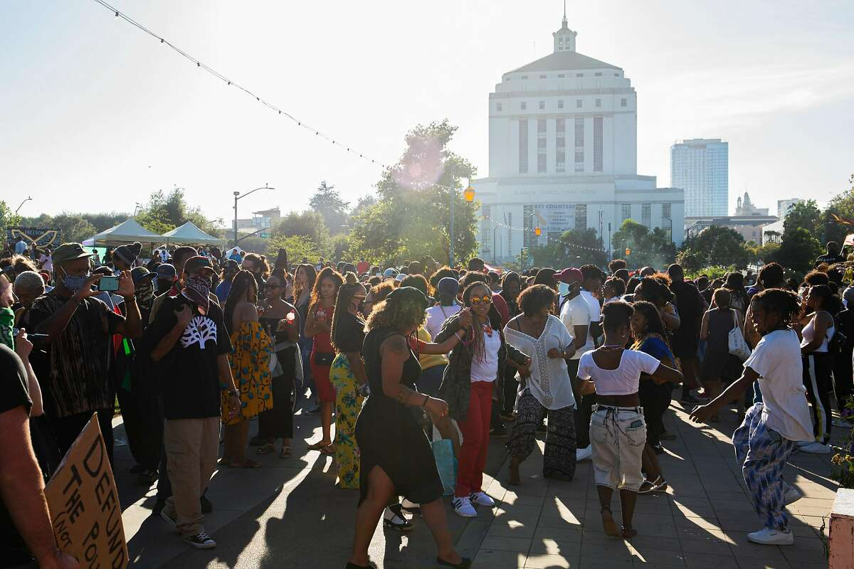 A crowd dance on the shore of Lake Merritt during the Juneteenth celebration in Oakland last year, a special time for activism.