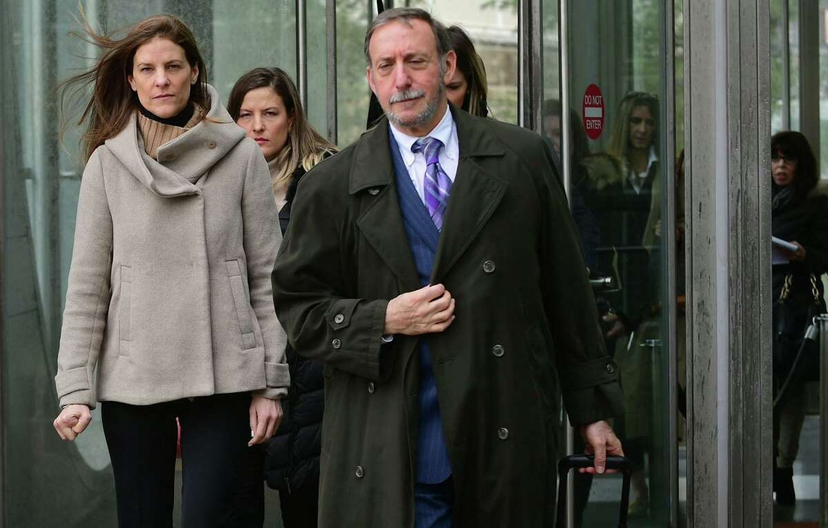 Michelle Troconis, charged with conspiracy to commit murder in the disappearance of Jennifer Dulos, exits the court following a pretrial hearing with her family and attorney Jon L. Schoenhorn Friday, February 6, 2020.
