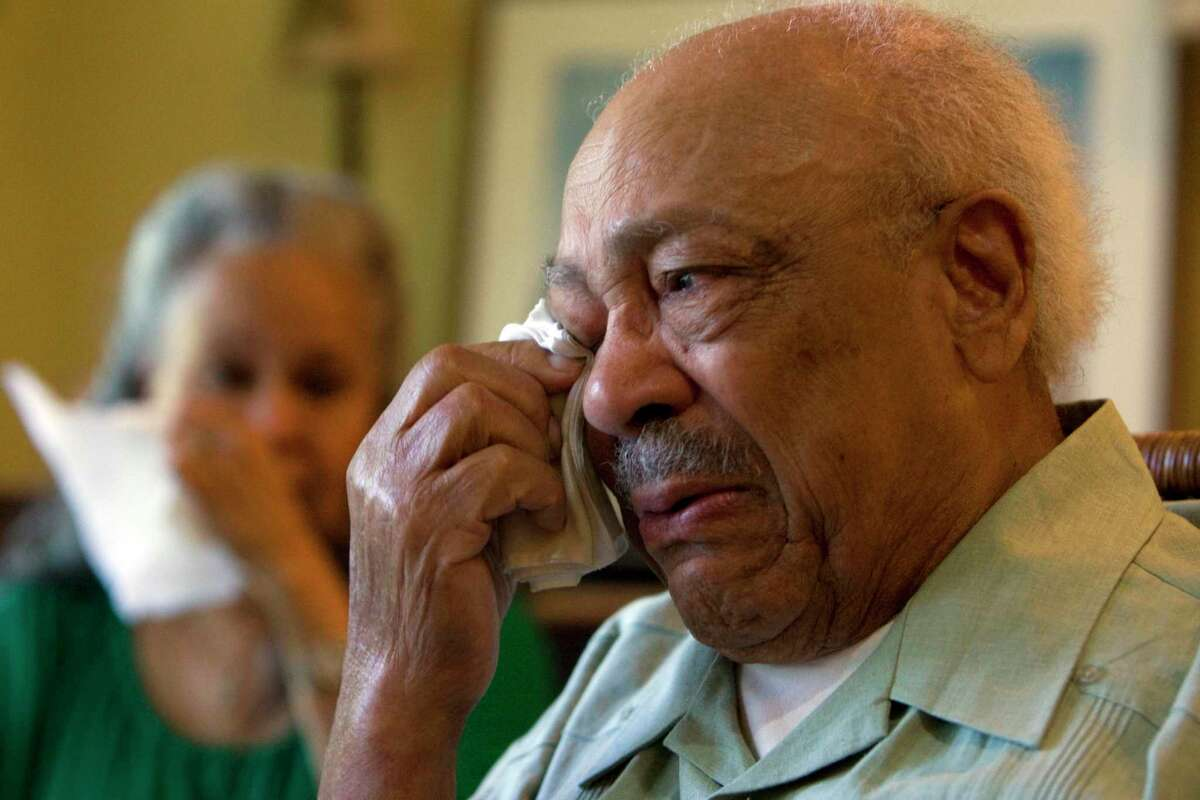 Recounting a story from his days as a Pullman porter at his Houston home, Frank Rollins, 93, weeps, next to his wife Patricia, 69, remembering the time while transporting Nazi POWs, he and his fellow African American railcar workers were not allowed to eat at a restaurant because they were black, but the Nazi POWs were allowed to eat at the restaurant Wednesday, April 22, 2009. Rollins was a Pullman porter on Pullman sleeping-railcars from 1942-1945. Before becoming a porter, Rollins was a dining car waiter. Next month, Rollins, along with other living Pullman porters, who were a part of the first black labor union in the country, will be honored in Philadelphia. ( Johnny Hanson / Chronicle )