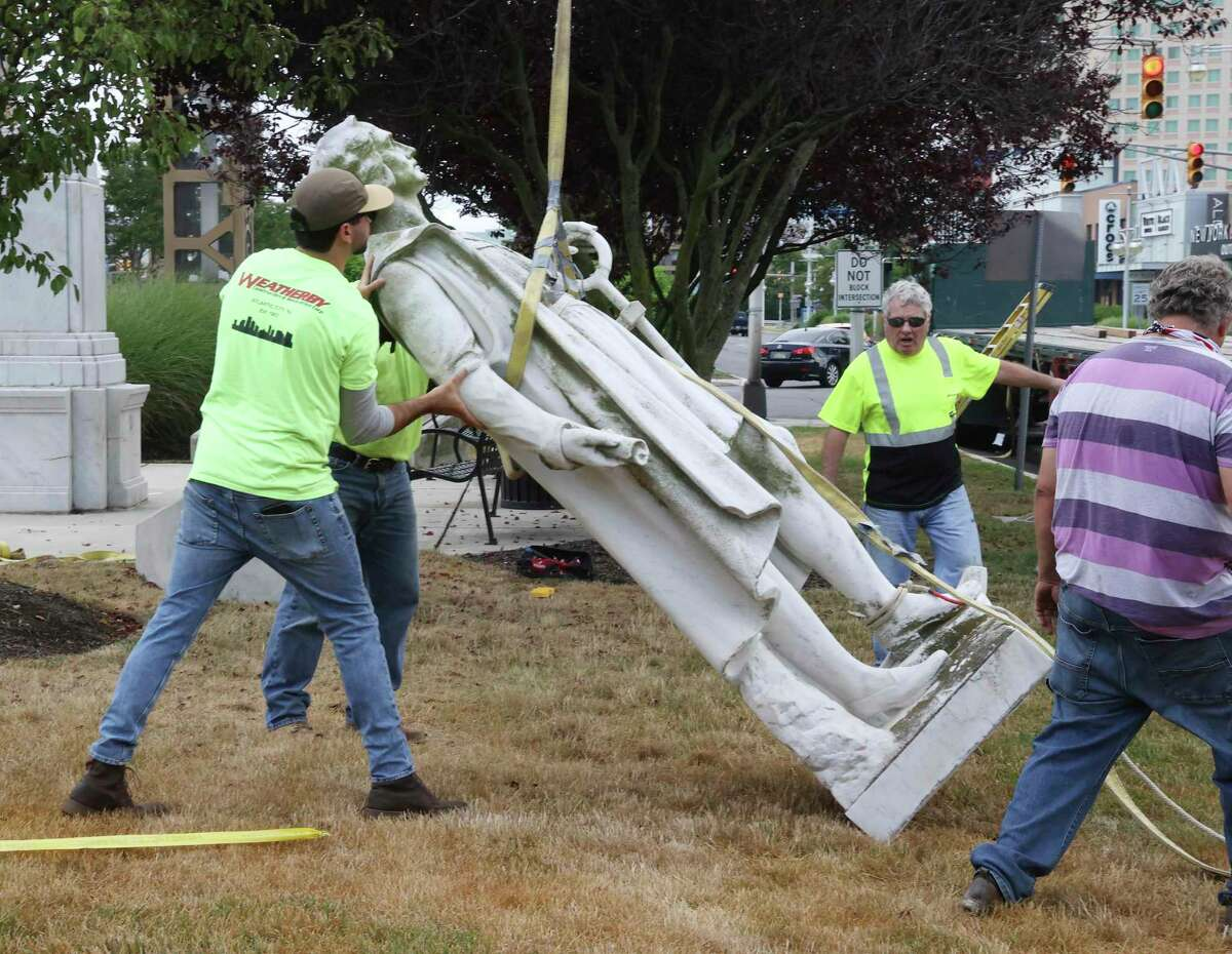 Workers remove a Christopher Columbus statue from Christopher Columbus Blvd. in Atlantic City, NJ on July 1. The Christopher Columbus monument, in the resort since 1958, was taken down from its location at the base of the Atlantic City Expressway.