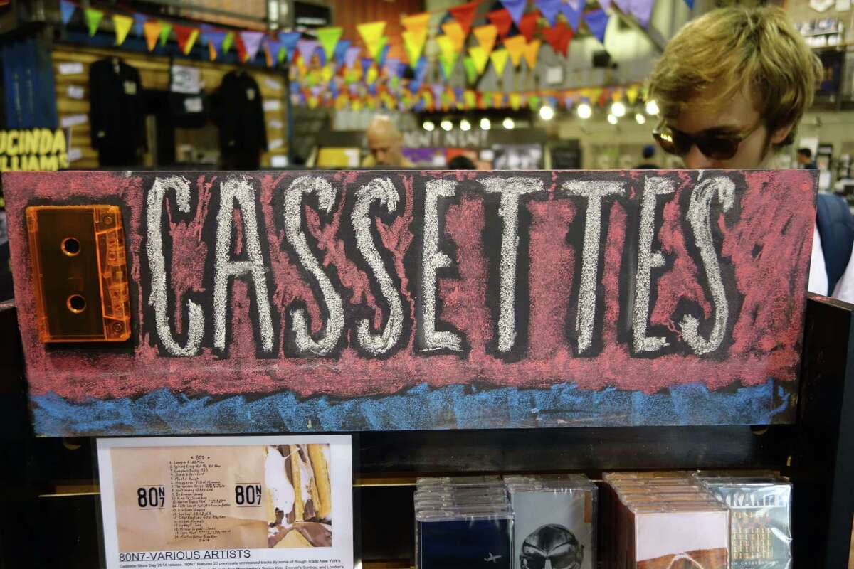 Customers select cassettes at the Rough Trade store during the second ever Cassette Store Day, held in the UK and the US, on September 27, 2014, in Brooklyn, New York. AFP PHOTO / William EDWARDSWilliam Edwards/AFP/Getty Images ORG XMIT: US-ENTERT