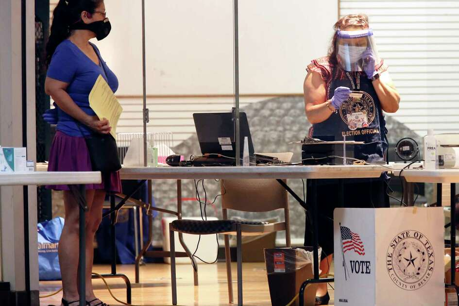 Poll workers wear protective gear at the Wonderland of the Americas Mall polling site last week. Early voting for the July 14th primary runoff election is ongoing. Take part in democracy - and stay safe.