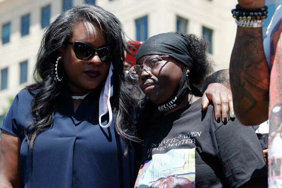 Colorado state Rep. Leslie Herod, D-Denver, left, consoles Sheneen McClain, whose son Elijah died in 2019 after he was stopped by Aurora Police Department officers while walking to his apartment. A reader recalls when police walked their beats and knew the people they protected and sees this as a way to improve community-police relations.