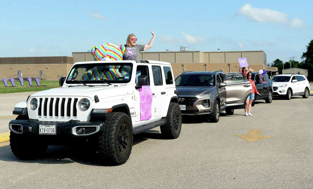 Port Neches Elementary School teachers paraded through the city Tuesday, waving to students and their families who gathered on lawns and streets to greet them. Principal Kim Carter organized Tuesday's parade after seeing a similar event on social media. Teachers, their children and the Indian Spirit rode in cars decorated with signs, and one with a gigantic teddy bear popping up through the top of a Jeep. Photo taken Tuesday, March 24, 2020 Kim Brent/The Enterprise