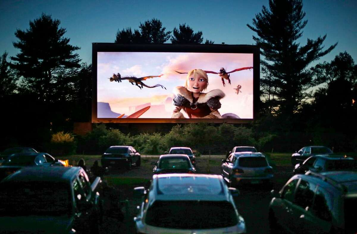 """A drive-in theater screens """"How to Train Your Dragon 2"""" in Saco, Maine, in June 2014. With nearly all of the nation's movie theaters shuttered during the pandemic, some drive-ins are the only show in town."""