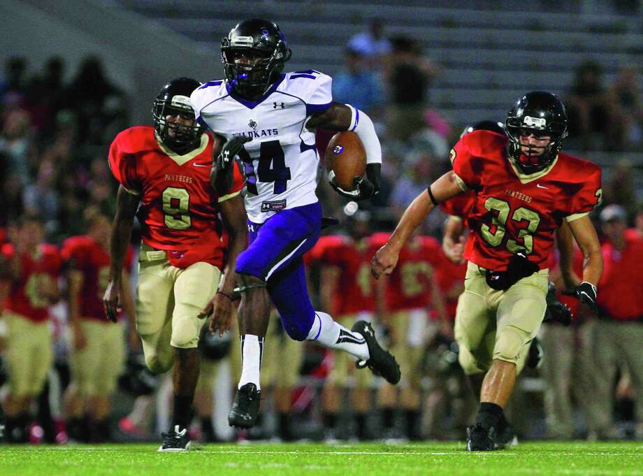 Willis running back Chris Platt run toward the end zone during a high school football game against Caney Creek Friday. Go to HCNPics.com to view and purchase this photo, and others like it. Photo: Staff Photo By Jason Fochtman, Photographer / Internal