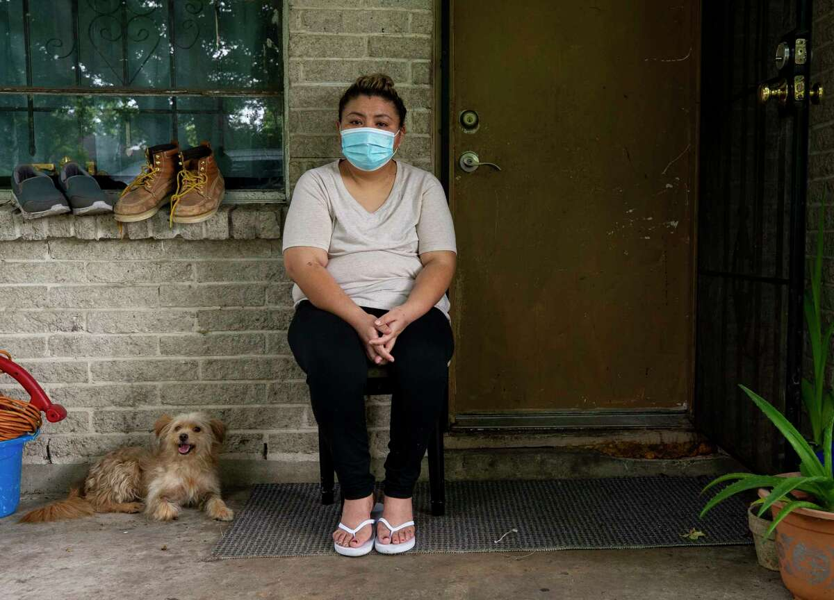 Andrea Seboyon, 34, poses for a photograph outside her home Monday, June 29, 2020, in Houston. Seboyan says she went to a Memorial Hermann location when she couldn't breath in early June, and was told she had pneumonia. She asked to be tested for COVID-19, insisting she couldn't breath, not was sent home with a prescription of Z-pack. Two days later she was admitted into the COVID-19 unit at United Memorial Medical Center.