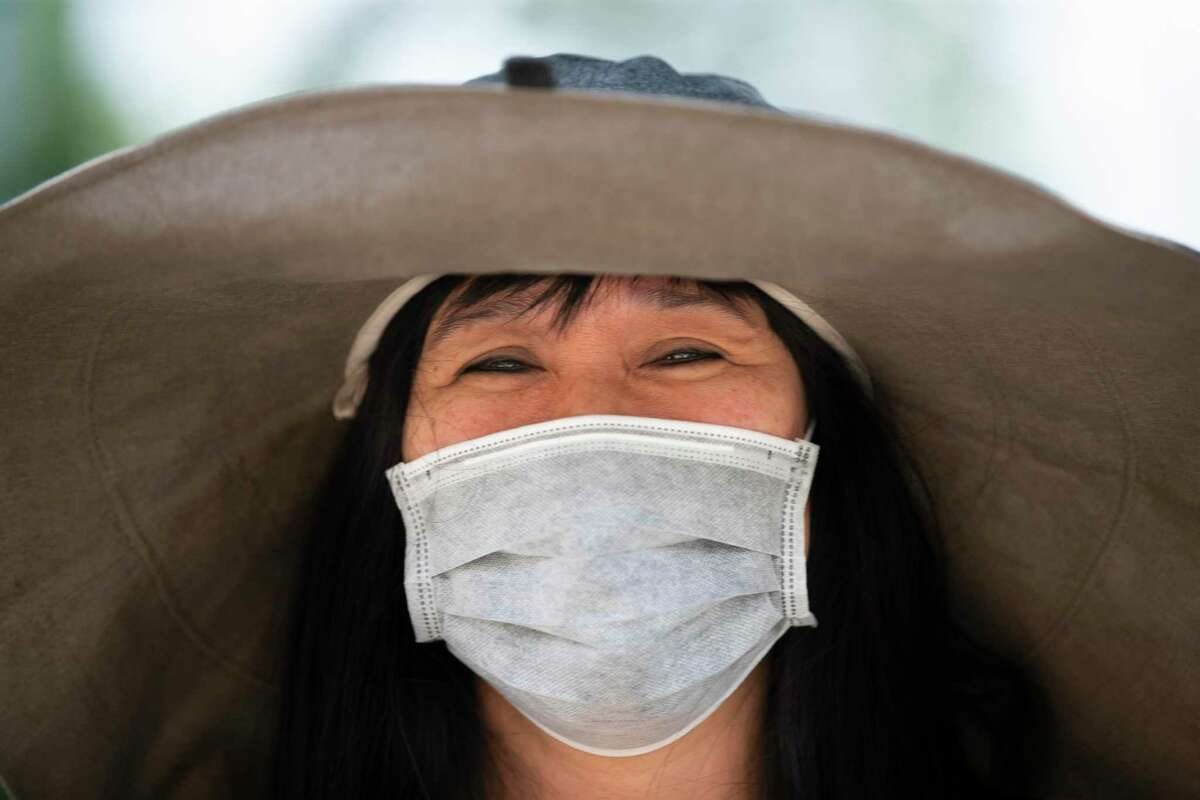 Jenny Nguyen, 51, wears a mask to Levy Park on Friday as a safety precaution against the novel coronavirus.
