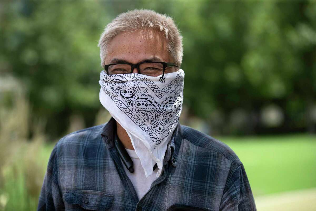 """""""It is cheaper if we all put on our masks and go to work, than to have the problem and pay for it by shutting the businesses,"""" said Loi Nguyen, 51, while wearing a bandana to cover his nose and mouth at the Levy Park on Friday, July 3, 2020, in Houston."""