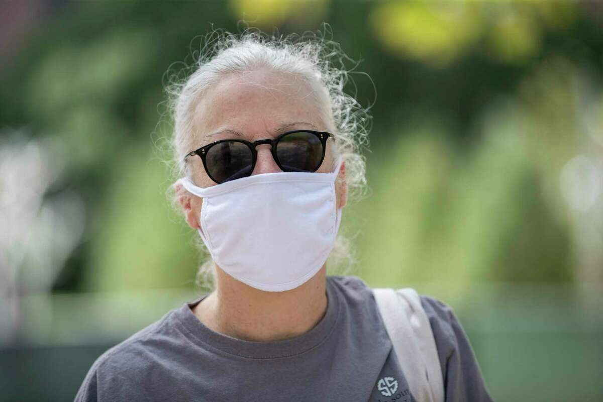 """""""Until you know someone who died, and we do, it doesn't become real,"""" said Fern Daves, 57, talking about the importance of wearing protective masks at Discovery Green on Friday, July 3, 2020, in Houston."""