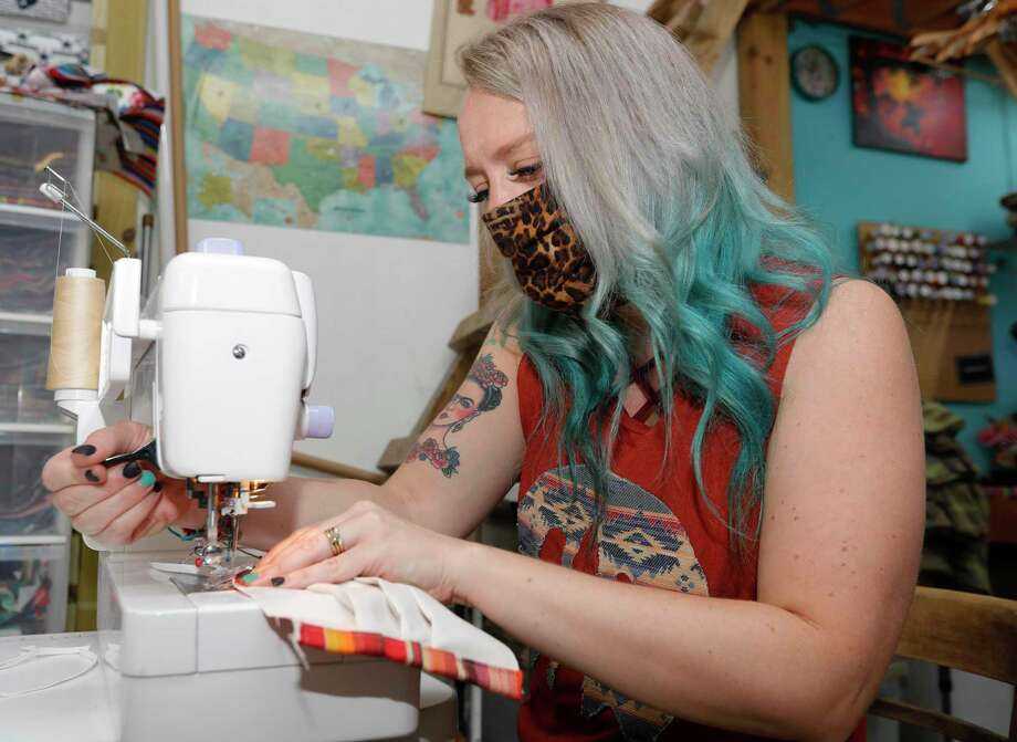 Sweet Texas Treasures Boutique owner Morgan Calhoun works on a face mask for a customer at Sweet Texas Treasures Boutique, Friday, July 3, 2020, in Montgomery. Gov. Greg Abbott's statewide face covering order, which affects most Texans, went into affect at noon in an effort to slow the spread of COVID-19. Photo: Jason Fochtman, Houston Chronicle / Staff Photographer / 2020 © Houston Chronicle