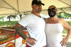 On Independence Day, attitudes about masks for coronavirus reflect the principles of the founding of the United States. Pictured are Massimo DeMedici and Liza Davis, in the bail bonds business, who have complex ideas about masks; and a scene in South Norwalk where a group of friends including A.J. Ibarrondo greeted one another with hugs.