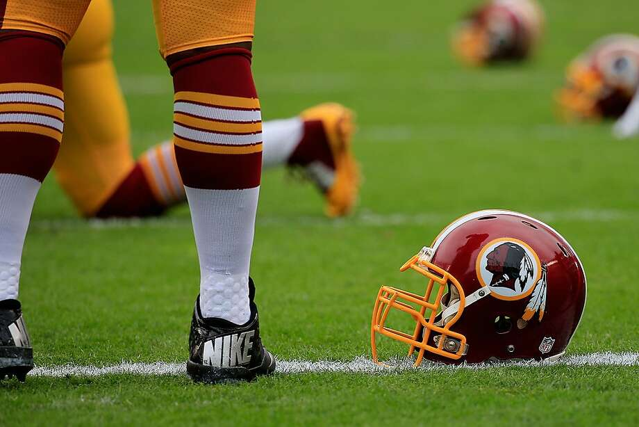A Washington Redskins helmet is seen on the field before a game in 2014. The team will undergo a review of its controversial name. Photo: Rob Carr / Getty Images 2014