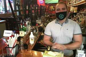 Edward Petri, manager and co-owner at Burger Bar & Bistro in South Norwalk, said the establishment is still losing at least half its business with the bar closed, but he supports Lamont's decision to delay reopening of bars and expansion of bar areas in restaurants.