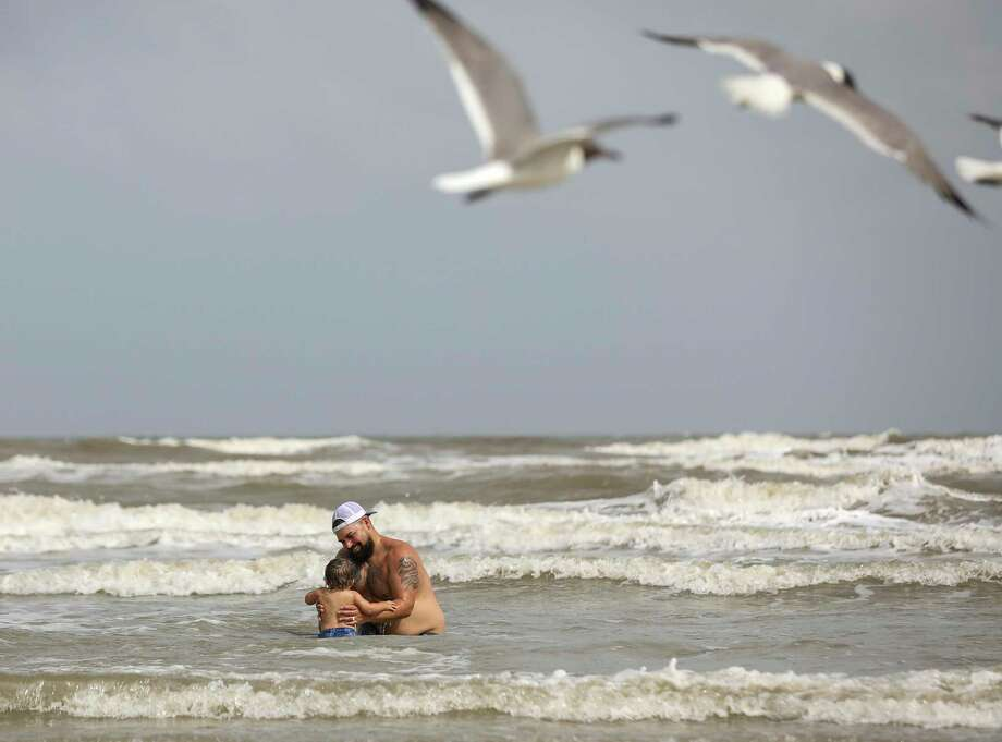 "Benjamin McCarthy plays with his son DeLuca, aged 15 months, Wednesday, July 1, 2020, at the beach in Galveston. City officials said the city will close its beaches to the public for the July 4th holiday weekend amid a spike in new coronavirus cases. ""I think more people are starting to get nervous,"" McCarthy said. Photo: Jon Shapley, Houston Chronicle / Staff Photographer / © 2020 Houston Chronicle"