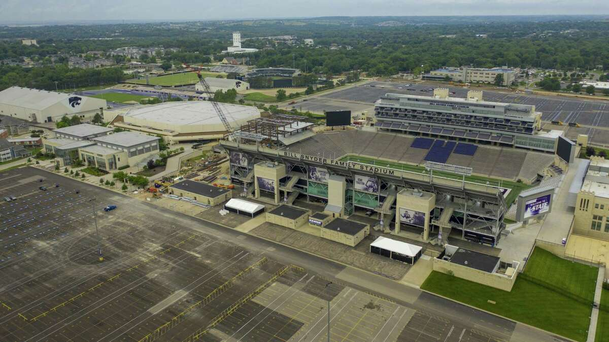 The Bill Snyder Family Stadium stands empty on the Kansas State University campus in this aerial photograph taken in Manhattan, Kansas, U.S., on Thursday, July 2, 2020. Kansas' top public health official predicted Wednesday that the state will face steeper increases in coronavirus cases and suggested that it blew its chance for a summer respite from the pandemic by reopening its economy too quickly, the Associated Press reports.