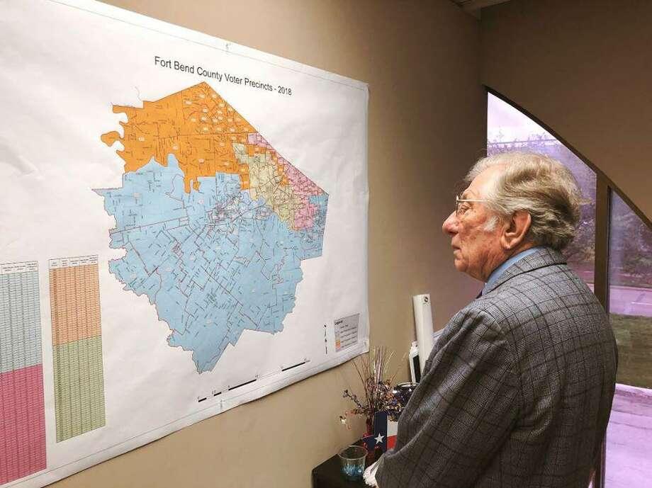 Mayor Leonard Scarcella surveys a map of Stafford in 2019. Photo: Courtesy City Of Stafford