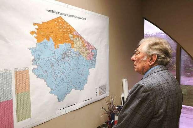 Mayor Leonard Scarcella surveys a map of Stafford in 2019.