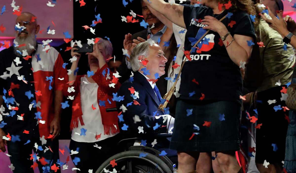 In this June 15, 2018 file photo, confetti falls as Texas Gov. Greg Abbott, center, greets supporters after speaking at the Texas GOP Convention, in San Antonio. As the Texas GOP presses ahead with plans for a July convention amid a worsening coronavirus outbreak, the state's largest medical group Tuesday June 30, 2020, urged the party to reconsider before thousands of Republican activists flock to Houston, which has become one of the nation's most troubling hotspots.