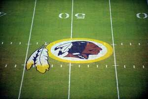 FILE - In this Aug. 28, 2009 file photo, the Washington Redskins logo is shown on the field before the start of a preseason NFL football game against the New England Patriots in Landover, Md. The Washington Redskins are undergoing what the team calls a a€œthorough reviewa€ of the nickname. In a statement released Friday, July 3, 2020, the team says it has been talking to the NFL for weeks about the subject. Owner Dan Snyder says the process will include input from alumni, sponsors, the league, community and members of the organization. FedEx on Thursday called for the team to change its name, and Nike appeared to remove all Redskins gear from its online store. (AP Photo/Nick Wass, File)