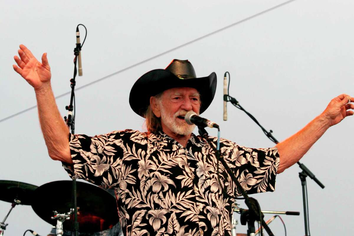 FILE - In this July 4, 2006, file photo, Willie Nelson addresses fans attending his Fourth of July Picnic in Ft. Worth, Texas. Willie Nelsona€™s annual Fourth of July Picnic is going ahead this year, but to reduce concerns about the coronavirus the event will be virtual. Fans can tune in to the nearly 50-year-old music bash Saturday via livestream. (AP Photo/Rex C. Curry, File)
