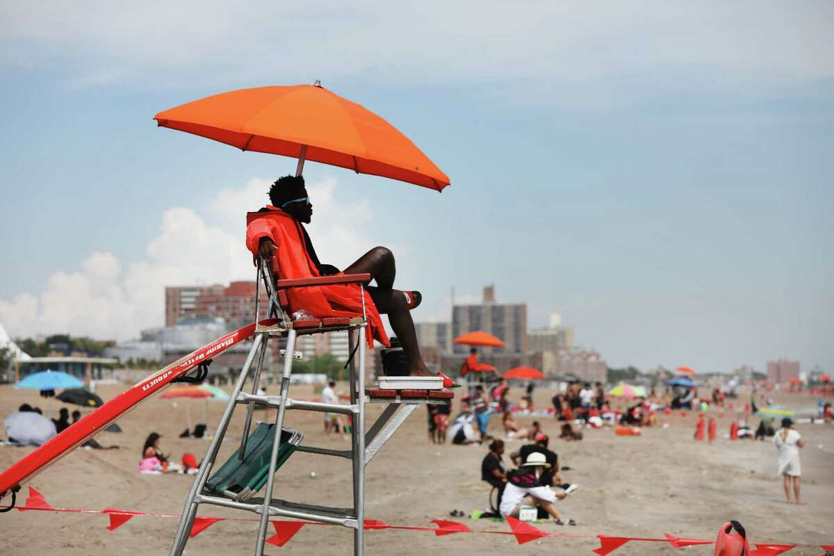 NEW YORK, NEW YORK - JULY 01: Lifeguards keep watch along the beach at Brooklyn's Coney Island on the first day that swimming is allowed at New York City beaches on July 01, 2020 in New York City. Area beaches had been closed to swimming due to concerns of crowding at beaches and the risk of spread of the coronavirus. (Photo by Spencer Platt/Getty Images)