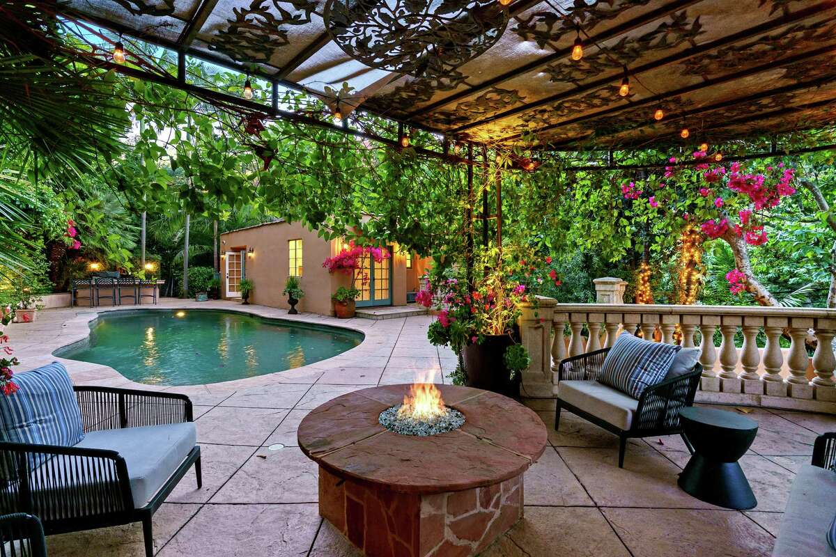 The actor Kunal Nayyar and his wife, model-designer Neha Kapur, are asking $3.995 million for their compound, which spans half an acre in Los Angeles' Hollywood Hills. The Mediterranean villa-style main house and two guesthouses are on the leafy property. Courtyards, patios and a swimming pool with a separate pool house fill out the grounds. (Joshua Spooner/TNS)