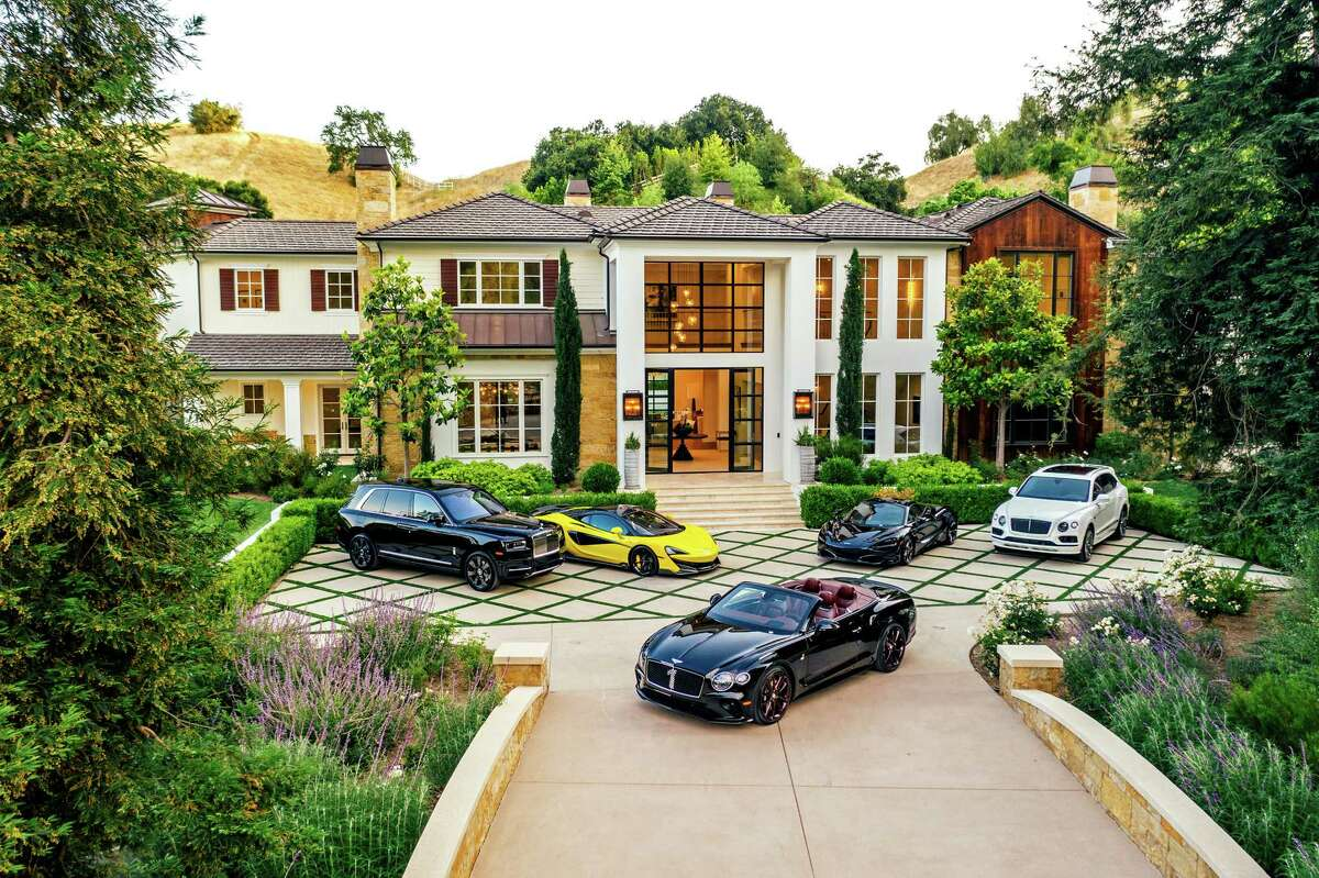 Abel Makkonen Tesfaye, better known by his stage name The Weeknd, listed his massive estate in Hidden Hills, California, for sale at $24.995 million. Redwood trees frame the front of the farmhouse-style mansion, which has nine bedrooms and 11 bathrooms plus a detached guesthouse. Features of the home include an eye-catching wine cellar, multiple bars and seven fireplaces. A basketball court sits at the far end of the the-acre property. (The Agency/TNS)