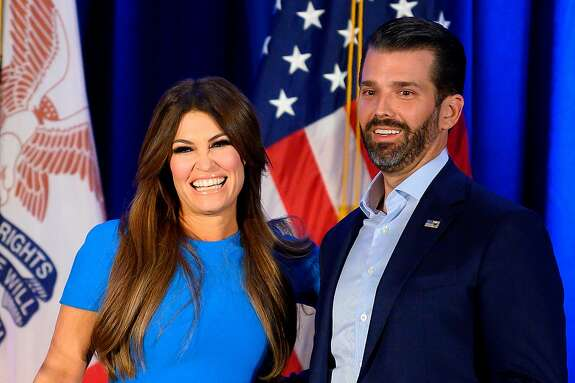 "(FILES) In this file photo taken on February 3, 2020 Donald Trump Jr. (R) and his girlfriend Kimberly Guilfoyle smile during a ""Keep Iowa Great"" press conference in Des Moines, IA. - Donald Trump Jr's his girlfriend Kimberly Guilfoyle tested positive for the coronavirus on July 3, 2020, US media reported. (Photo by JIM WATSON / AFP) (Photo by JIM WATSON/AFP via Getty Images)"