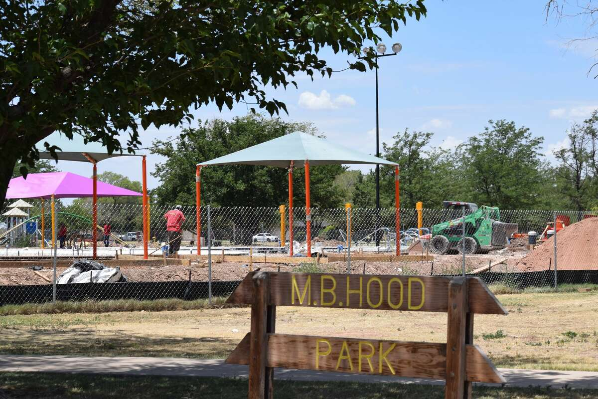 Construction workers continue work at the Plainview Aquatic Center at M. B. Hood Park at 3300 W. 16th St. Thursday. Construction of the aquatic center is behind but anticipated to wrap by mid to late July.