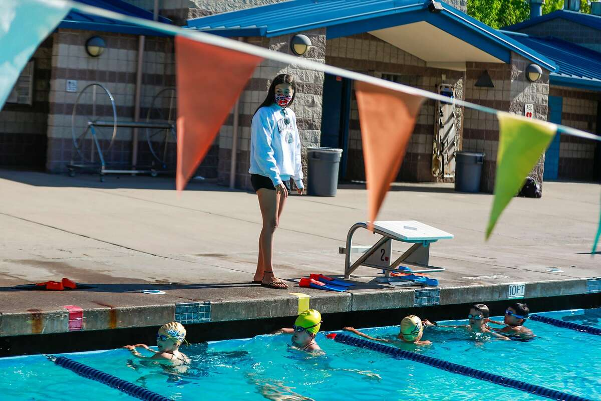 Instructor Sophia Riva watches her students as she teaches swim camp at Soda Aquatic Center at Campolindo High School in Moraga, California on Thursday, July 2, 2020.