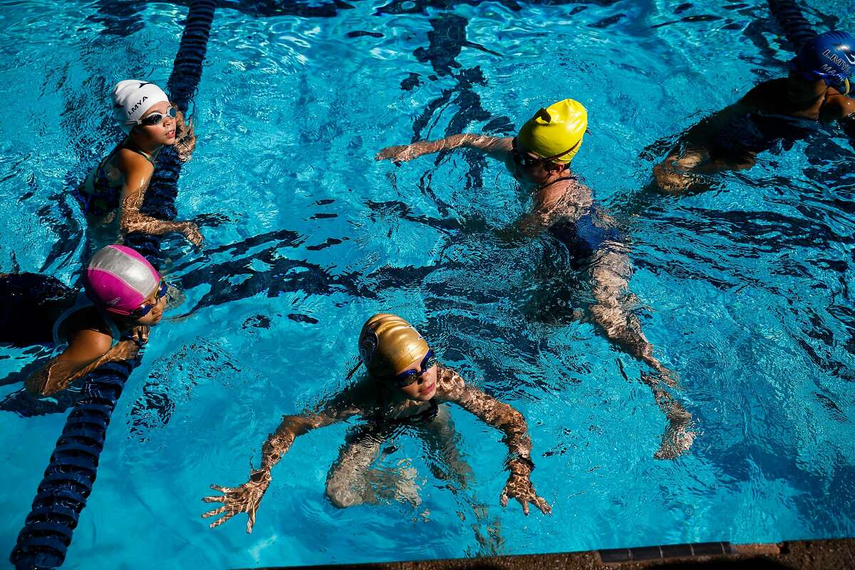 8-year old students during swim camp at Soda Aquatic Center at Campolindo High School in Moraga, California on Thursday, July 2, 2020.