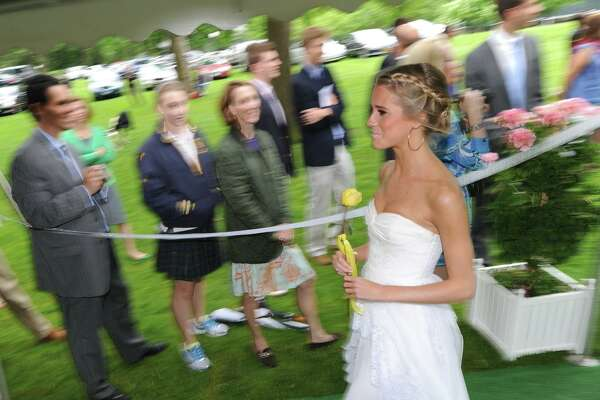 She may be dressed in white, but this isn't her wedding. Then-18-year-old Cassidy Gifford, of Greenwich, during her Greenwich Academy graduation at the main campus in Greenwich, Thursday, May 24, 2012.