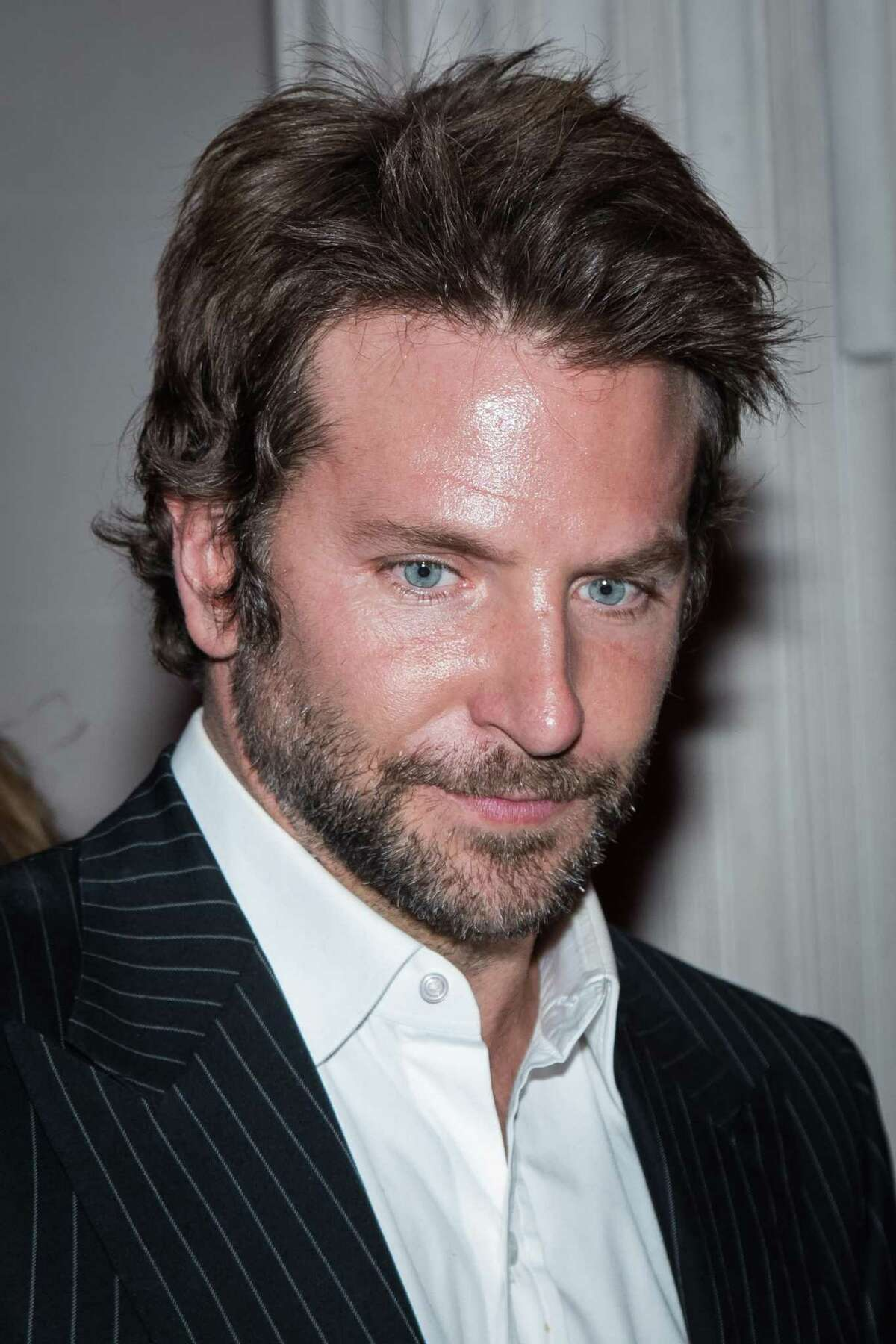 Actor Bradley Cooper arrives at the L'Oreal Red Obsession Party in Paris, Tuesday, March 8, 2016. (AP Photo/Vianney le Caer)