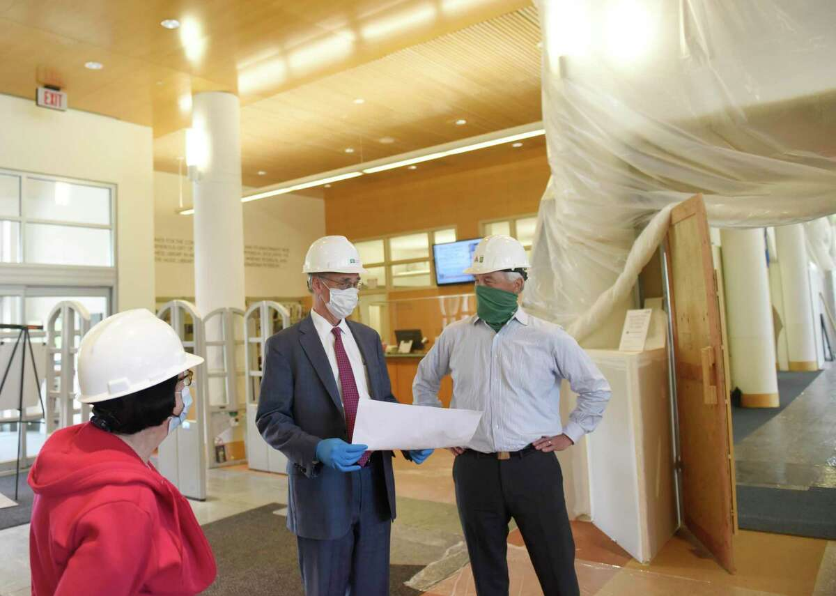 Project manager Thomas Heagney, left, and Ashforth Company Executive Vice President Hank Ashforth lead a tour of the renovation construction project at Greenwich Library in Greenwich, Conn. Thursday, June 25, 2020. The library has been closed during the coronavirus outbreak, so the renovation project has been able to move forward ahead of schedule and is expected to be done before the end of 2020.