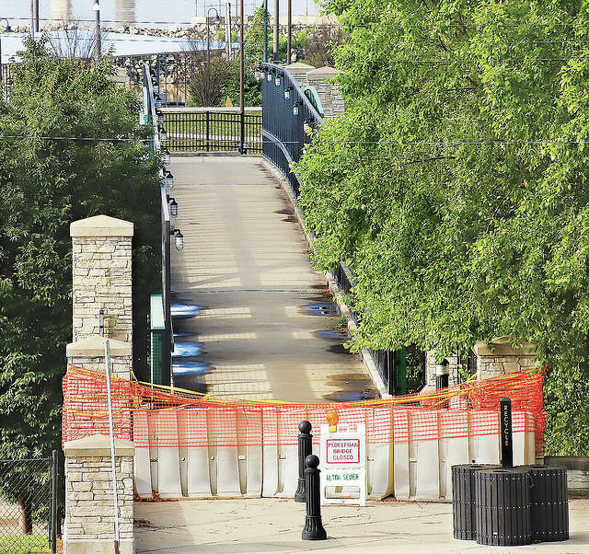 The Pedestrian Bridge in Alton, which was closed for repairs last year, is back open and able to carry pedestrians through a green scene of trees and grass. The bridge connects East Broadway to Riverfront Park and the Liberty Bank Ampitheater. It provides safe park access for pedestrians and bicycle riders. (File photo)