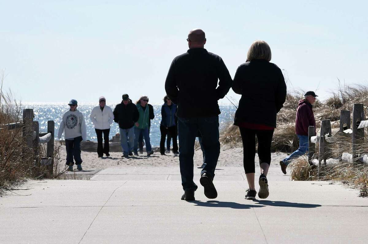 Crowds of walkers lined the walkways at Hammonasset Beach State Park's West Beach in Madison on March 15, 2020.