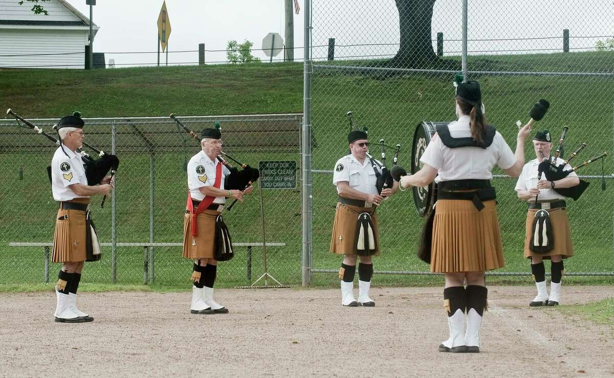 The Celtic Cross Pipes and Drums perform during the 4th of July opening ceremony at Memorial Park in New Fairfield. Saturday, July 4, 2020