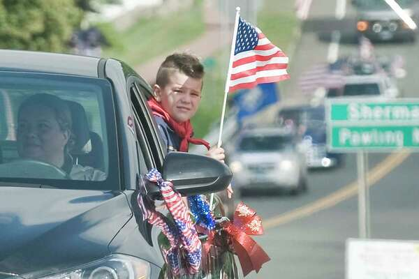 The 4th of July car parade proceeds along Pembroke Road in New Fairfield. Saturday, July 4, 2020