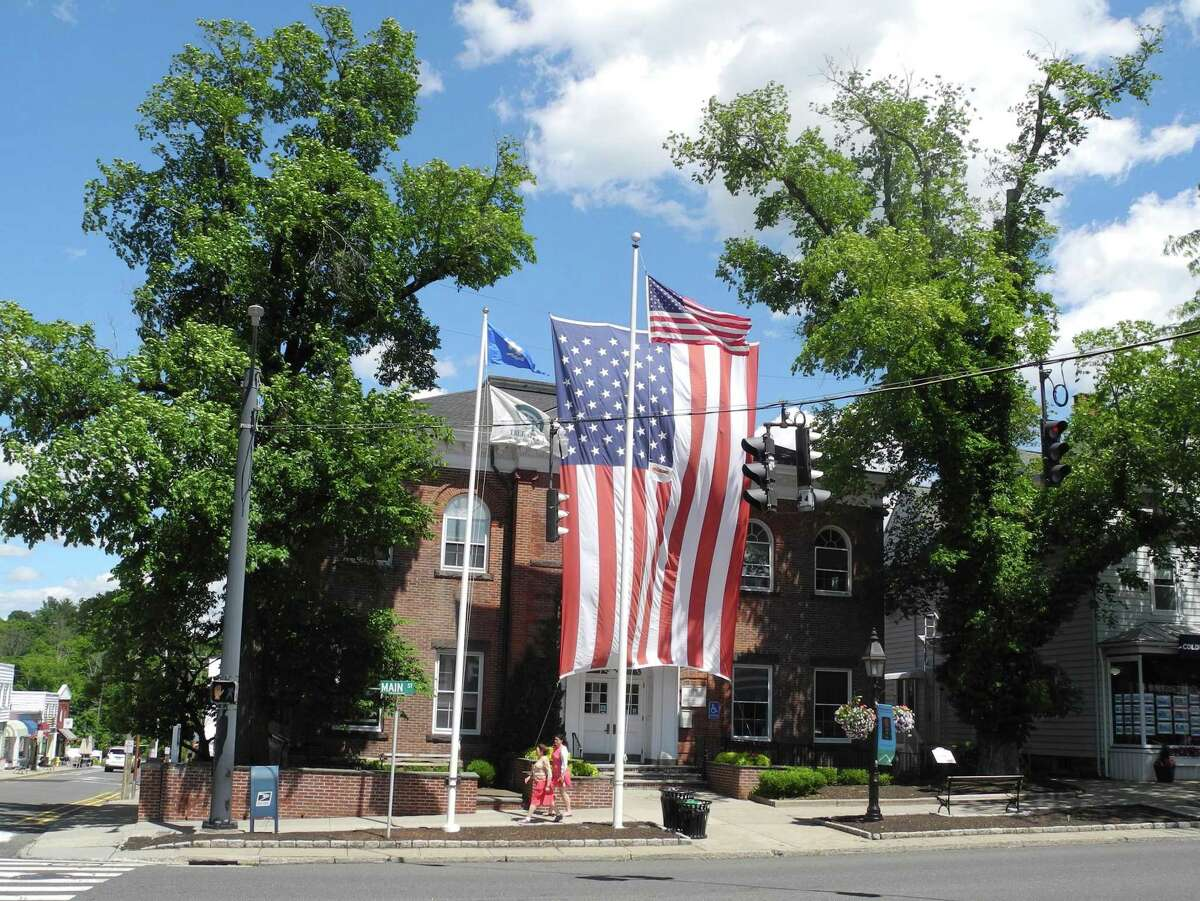 A giant American flag drapes the front of Ridgefield Town Hall on June 25, 2018. The flag has not been hung since two elm trees that supported it were removed later that month.