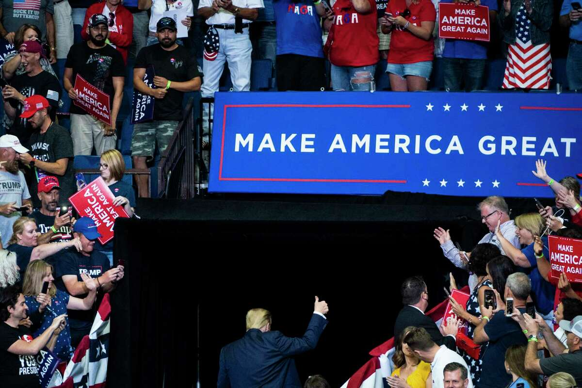 """Supporters cheer as President Donald Trump departs the stage at the BOK Center in Tulsa, Okla., during a """"Make America Great Again"""" rally June 20."""