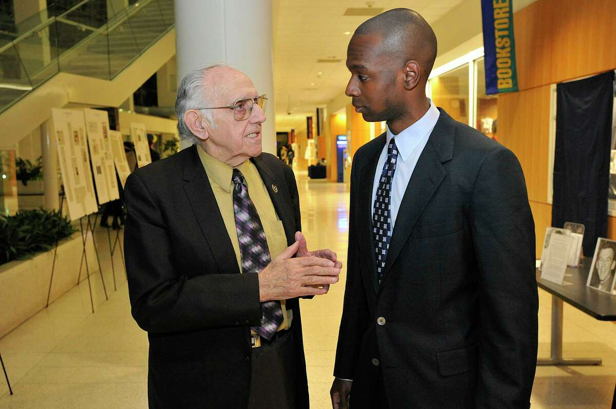 Inductees former Stamford Mayor Bruno Giordano, left, and Craig Austrie chat during the UConn Fairfield County Sports Hall of Fame induction and dedication ceremony of the UConn wing of the Fairfield County Sports Hall of Fame to Dr. David Mazza at University of Connecticut's Stamford campus in Stamford, Conn., on Thursday, Nov. 13,2014.